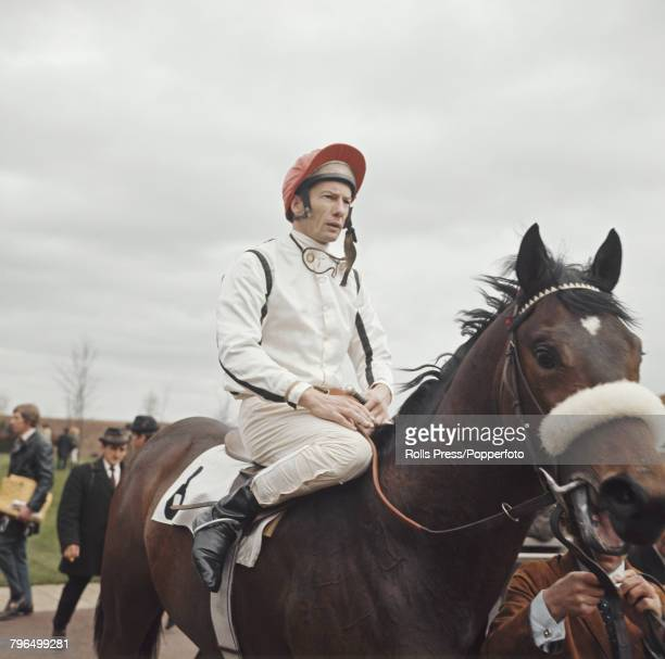 English jockey Lester Piggott pictured mounted on a racehorse prior to racing at a horse race meeting at a racecourse in England in 1972