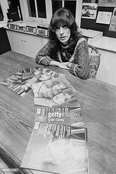 English journalist and broadcaster Bel Mooney with a spread of Viva magazines circa 1980