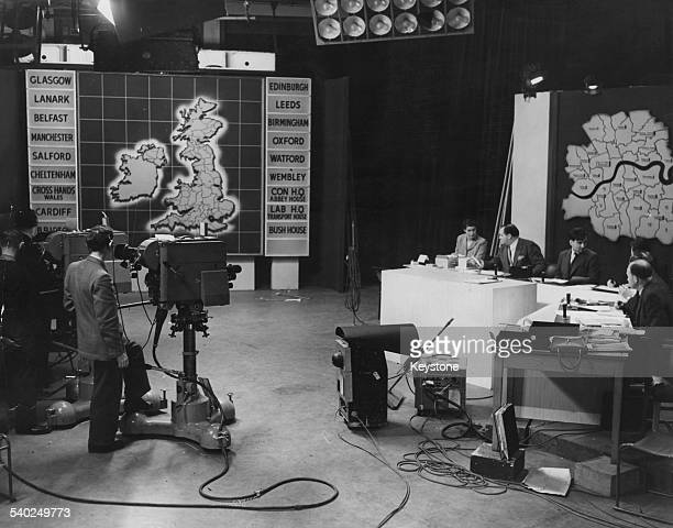 English journalist and broadcaster Richard Dimbleby prepares with statisticians during rehearsals for the BBC's General Election live coverage at...
