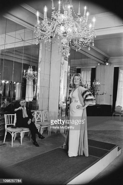 English journalist Jean Rook with British fashion designer Norman Hartnell , UK, 7th November 1975.
