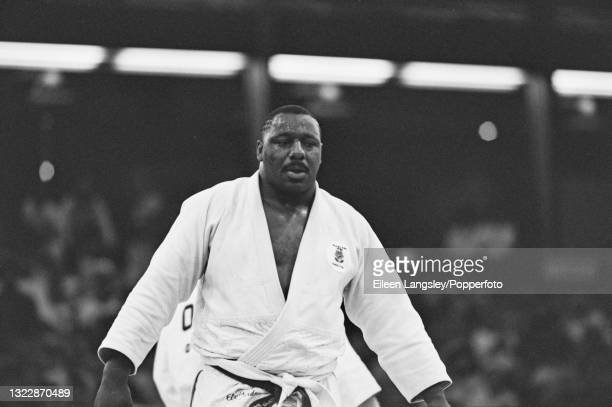 English judoka Elvis Gordon in competition to win the gold medal for England in the Men's heavyweight judo event at the 1990 Commonwealth Games in...