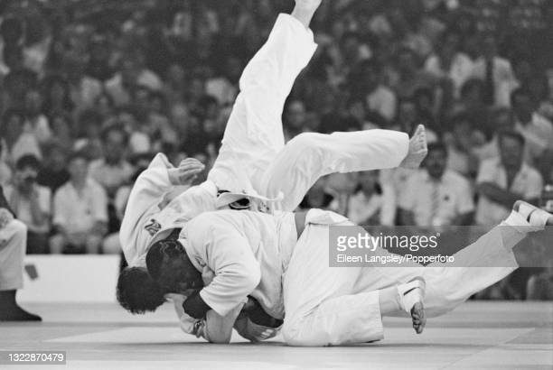 English judoka Elvis Gordon , on right, in competition against Wayne Watson of New Zealand to win the gold medal for England in the Men's heavyweight...