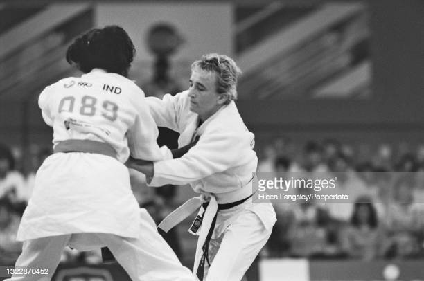 English judoka Karen Briggs in competition against T Mannenagaraj of India to win the gold medal for England in the Women's extra lightweight judo...