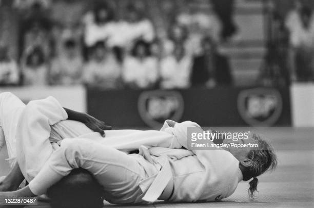 English judoka Karen Briggs in competition to win the gold medal for England in the Women's extra lightweight judo event at the 1990 Commonwealth...