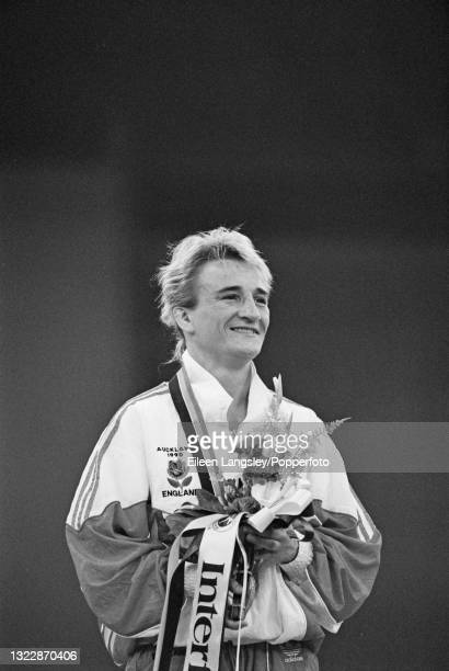 English judoka Karen Briggs stands on the medal podium to receive her gold medal for England after finishing in first place to win the Women's extra...