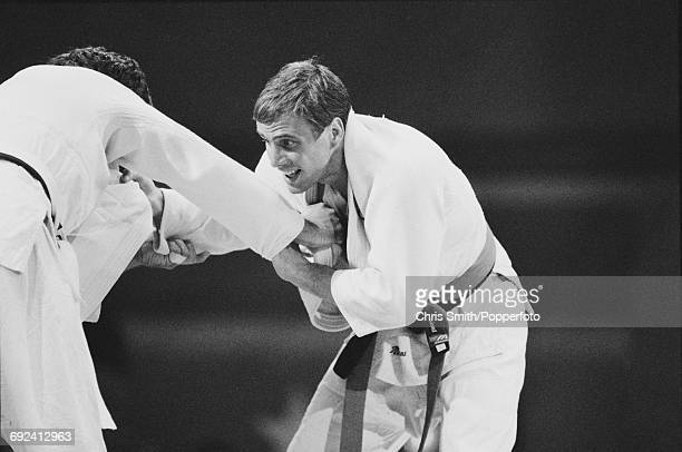 English judoka Neil Adams of the Great Britain team competes against opponent in the Men's half middleweight Judo event at the 1984 Summer Olympics...