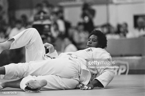 English judoka Sharon Lee in competition against Geraldine Dekker of Australia to win the gold medal for England in the Women's heavyweight judo...