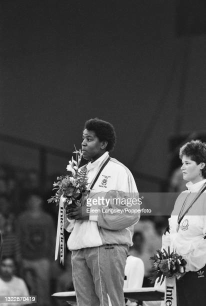 English judoka Sharon Lee stands on the medal podium to receive her gold medal for England after finishing in first place to win the Women's...