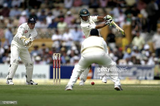 English keeper Geraint Jones watches Ian Bell field a shot by Australian Captain Ricky Ponting in Day Three of the Second Ashes Test at the Adelaide...