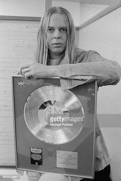 English keyboard player and composer Rick Wakeman with an award from AM Records for sales of his album 'Journey To The Centre Of The Earth' 10th...