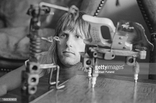 English keyboard player Keith Emerson with a sculpture of a pianist at his home, 4th September 1971.