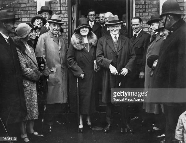 English Labour statesman Philip Snowden leaving the Labour Party Conference at Brighton with his wife and Mr Henderson Original Publication People...