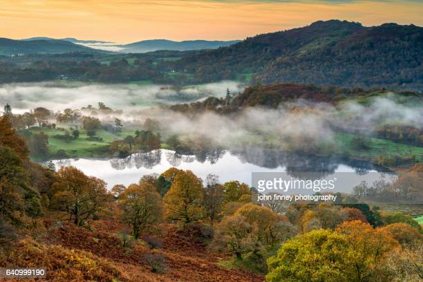 english lake district in autumn on a misty morning. lake district national park. uk. - ambleside stock photos and pictures