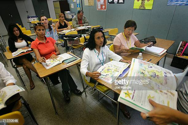 English language students listen to their teacher Radka Tomasek at the English Center June 16 2006 in Miami Florida The school holds adult education...