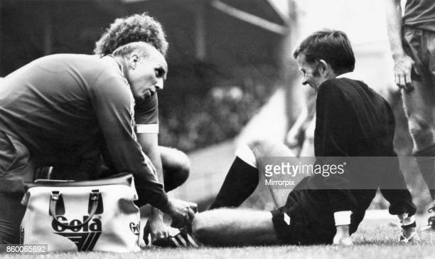English League Division One match at Anfield, Liverpool 0 v Aston Villa 0.Liverpool coach Ronnie Moran attends to the referee who has gone down with...