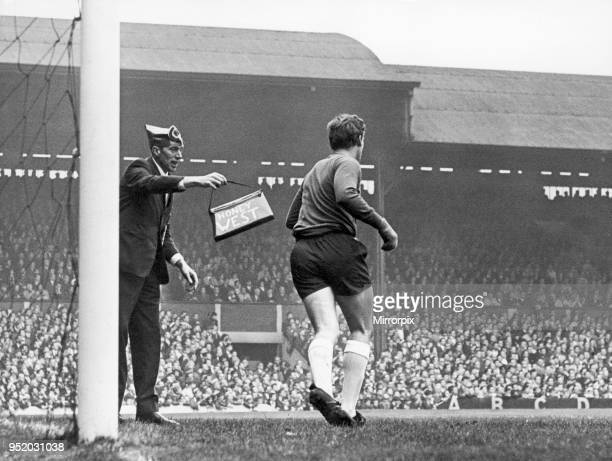 English League Division One match at Anfield Liverpool 1 v Everton 0 A fan comes onto the field during play and gives Everton keeper West a handbag...