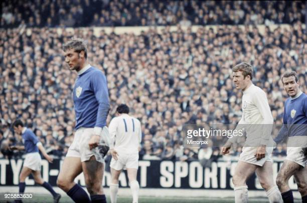 English League Division One match at Elland Road. Leeds United 2 v Leicester City 0. Leicester pair Graham Cross and Alan Woollet with Mick Jones of...