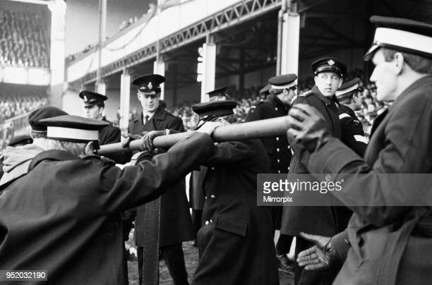 English League Division One match at Goodison Park. Everton 1 v Liverpool 0. St Johns Ambulancemen with collapsed steel girder taken from the stands...