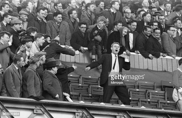 English League Division One match at Goodison Park. Everton 4 v Fulham 1. The win gave Everton the title on the last day of the season. Injured...
