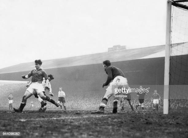 English League Division One match at Old Trafford, Manchester United 1 v Bolton Wanderers 1, United left back Duncan Edwards tries to intercept a...