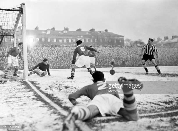 Everton forward Bob Latchford on the ball as Wolverhampton Wanderers defender Parkin slides in to challenge in the snow during the league match at...