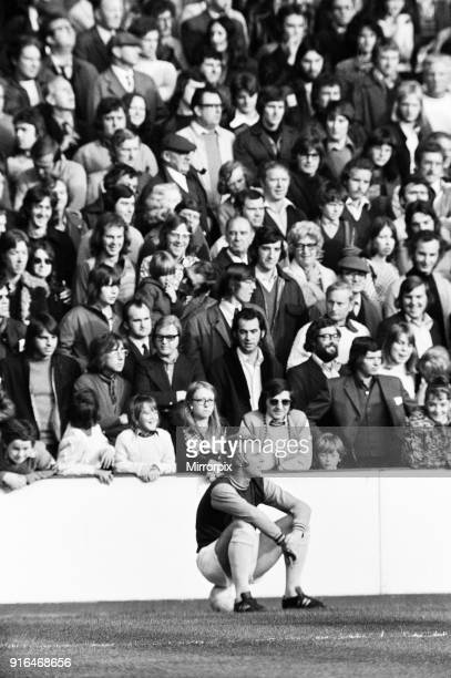 English League Division One match at Upton Park West Ham 0 v Derby County 0 Bobby Moore sitting on the ball watched by Hammers fans 27th October 1973