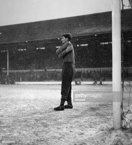 English League Division One match at White Hart Lane. Tottenham Hotspur 2 v Blackpool 0. Spurs goalkeeper Bill Brown feels the cold as the snow comes...