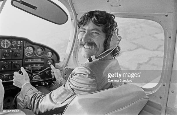 English long distance runner David Bedford at the controls of an aircraft, UK, 14th July 1973.