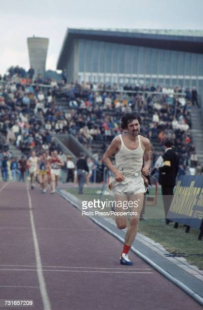 English long distance runner David Bedford pictured competing to finish in first place to win the 10000 metres event at the 1971 Amateur Athletics...