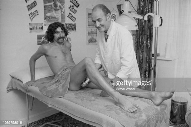 English long distance runner David Bedford receives treatment for his hamstring injury from physiotherapist Ted Chappell at a clinic in England on...