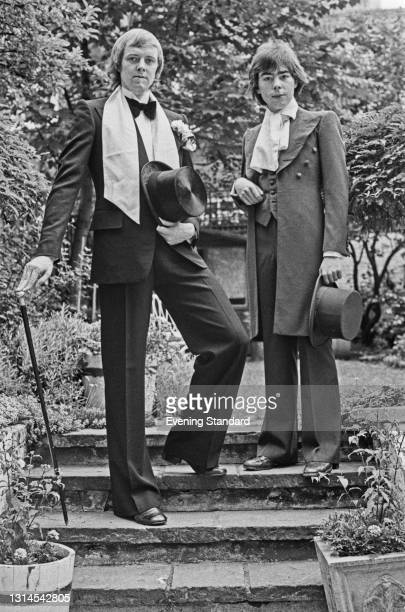 English lyricist Tim Rice and composer Andrew Lloyd Webber wearing formal attire, UK, 8th August 1973. Their musical 'Joseph and the Amazing...