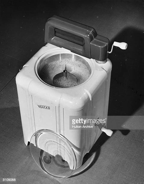 English made Vulcan top-loader washing machine with a mangle attached.