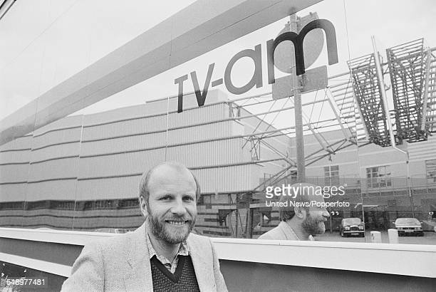 English media executive and programme director at television company TVam Greg Dyke pictured standing outside the entrance to the TVam office...