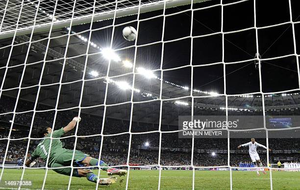 English midfielder Ashley Young misses a penalty by Italian goalkeeper Gianluigi Buffon during the penalty shoot out at the end of the Euro 2012...
