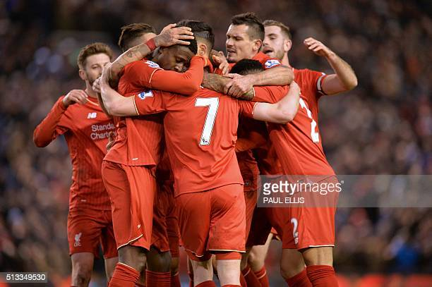 English midfielder James Milner celebrates with teammates after scoring their second goal during the English Premier League football match between...
