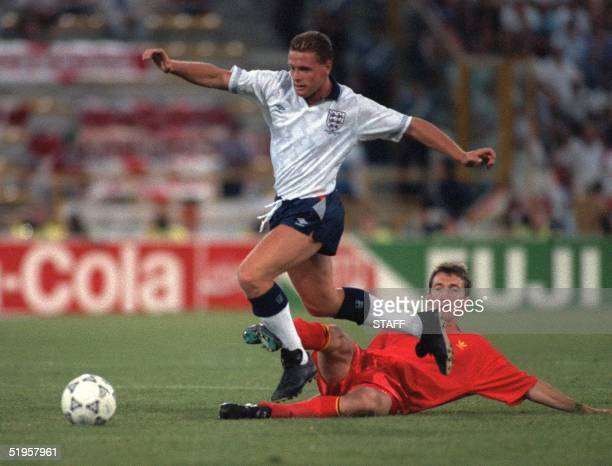 English midfielder Paul Gascoigne jumps over the attempted tackle of his Belgian counterpart Franky Van Der Elst during the World Cup second round...