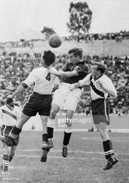 English midfielder Thomas Finney tries to head the ball between American defenders Charlie Colombo and Edward John McIlvenny 29 June 1950 in Belo...