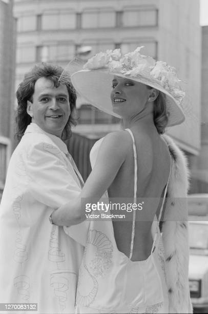 English milliner David Shilling with a model wearing one of his hats, UK, 11th June 1985.