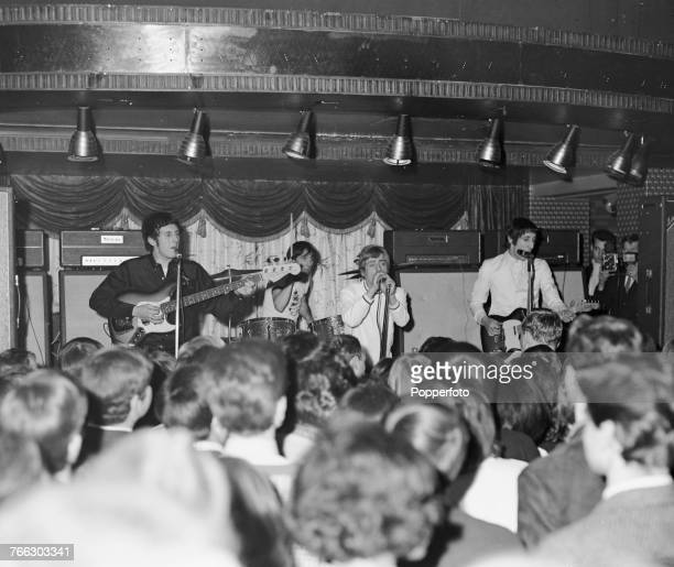 English mod rock group The Who perform live on stage at a small club venue during a tour of the United Kingdom circa March 1966 The group are from...