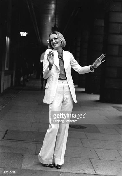 English model, actress and singer Twiggy, born Lesley Hornby launches Oxford Bags, worn with a matching jacket. This fashion was featured in the Ken...