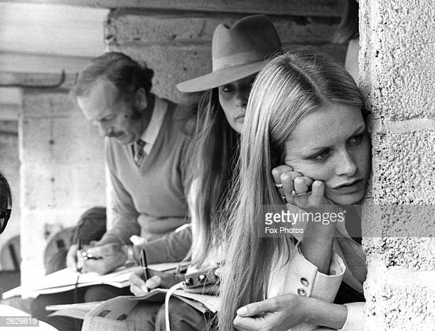 English model, actress and singer Twiggy in the pits during the British Grand Prix at Brands Hatch in Kent.