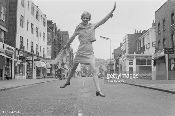 English model actress and singer Twiggy midair in the middle of King's Road in Chelsea London UK 13th June 1966