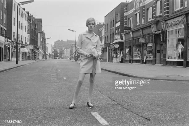 English model, actress, and singer Twiggy standing in the middle of King's Road in Chelsea, London, UK, 13th June 1966.