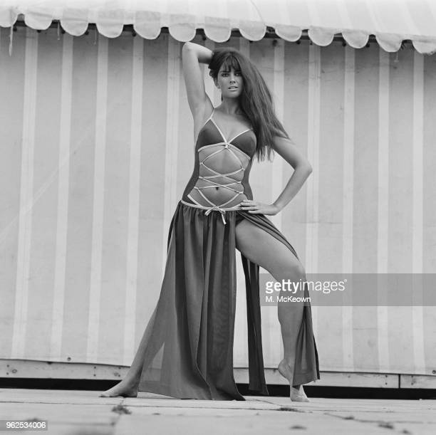 English model and actress Caroline Munro wears a swimsuit teamed with a hipster skirt on 5th October 1970