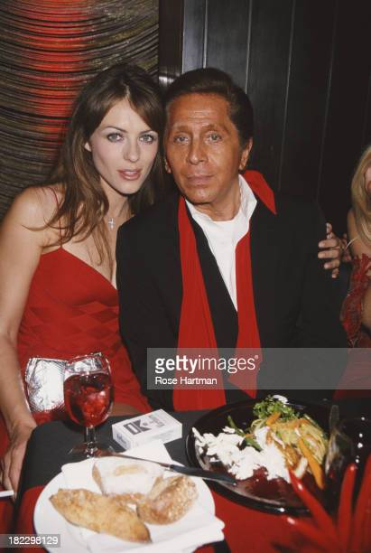 English model and actress Elizabeth Hurley with Italian fashion designer Valentino Garavani at the Four Seasons Restaurant New York City circa 1997