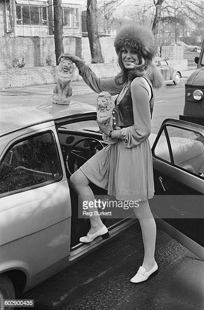 English model and actress Joanna Lumley with two lion statuettes UK 8th April 1970
