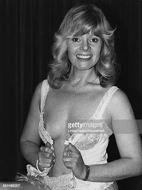 English model and actress Mary Millington who appears in the adult film 'Come Play With Me' pictured wearing underwear and a monogrammed necklace in...