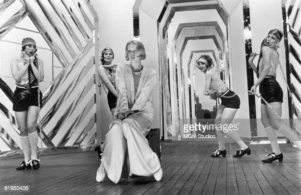 English model and actress Twiggy as Polly Browne with dancers in a scene from the fim version of Sandy Wilson's musical 'The Boy Friend' directed by...