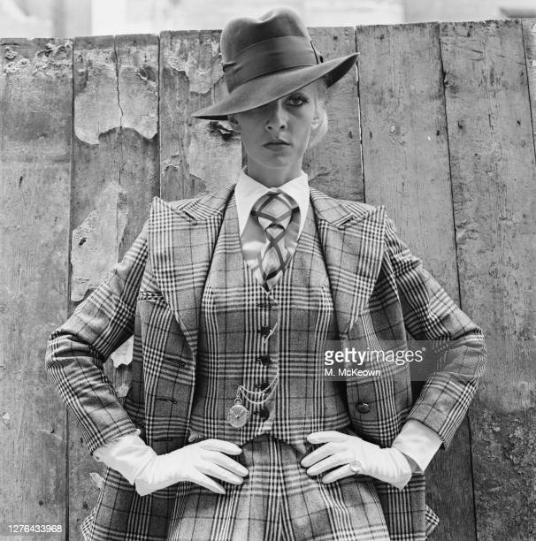 English model and actress Vicki Hodge wearing a gangsterstyle checked three piece suit complete with watch chain London UK 4th August 1972