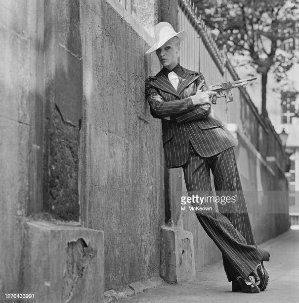 English model and actress Vicki Hodge wearing an American gangsterstyle trouser suit with a toy gun and a white hat London UK 4th August 1972